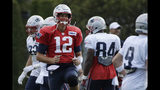New England Patriots quarterback Tom Brady (12) smiles as he warms up with teammates at NFL football practice, Monday, Aug. 19, 2019, in Foxborough, Mass. (AP Photo/Elise Amendola)
