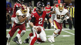 Atlanta Falcons quarterback Matt Ryan (2) runs out of the pocket against the Washington Redskins during the first half an NFL preseason football game, Thursday, Aug. 22, 2019, in Atlanta. (AP Photo/John Bazemore)