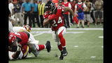 Atlanta Falcons running back Devonta Freeman (24) runs out of the backfield against the Washington Redskins during the first half an NFL preseason football game, Thursday, Aug. 22, 2019, in Atlanta. (AP Photo/John Bazemore)