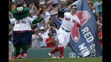 Boston Red Sox's Brock Holt celebrates his game-winning RBI single during the 10th inning of a baseball game against the Kansas City Royals that was suspended by rain with the scored tied on Aug. 8, and continued at Fenway Park in Boston, Thursday, Aug. 22, 2019. (AP Photo/Michael Dwyer)