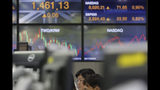 A currency trader watches computer monitors at the foreign exchange dealing room in Seoul, South Korea, Thursday, Aug. 22, 2019. Asian stock markets are mixed Thursday following Wall Street's rebound as investors looked ahead to a speech by the U.S. Federal Reserve chairman for clues about possible interest rate cuts. (AP Photo/Lee Jin-man)