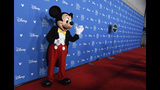 Mickey Mouse waves to members of the media at the Disney Legends press line during the 2019 D23 Expo, Friday, Aug. 23, 2019, in Anaheim, Calif. (Photo by Chris Pizzello/Invision/AP)