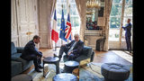 French President Emmanuel Macron, left, talks to Britain's Prime Minister Boris Johnson during their meeting at the Elysee Palace, Thursday, Aug. 22, 2019 in Paris. Boris Johnson traveled to Berlin Wednesday to meet with Chancellor Angela Merkel before heading to Paris to meet with French President Emmanuel Macron. (Christophe Petit Tesson, Pool via AP)