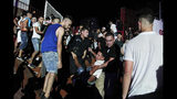 A man is evacuated during Algerian rap artist Abderraouf Derradji's concert, known as Soolking, at a stadium in Algiers, Thursday, Aug. 22, 2019. The concert caused some deaths and injuries in a stampede as fans thronged an entrance at the rap concert in the Algerian capital. (AP Photo/Fateh Guidoum)