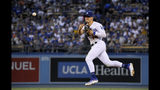 Los Angeles Dodgers second baseman Enrique Hernandez throws out Toronto Blue Jays' Derek Fisher at first during the second inning of a baseball game Thursday, Aug. 22, 2019, in Los Angeles. (AP Photo/Mark J. Terrill)