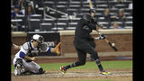 Atlanta Braves' Billy Hamilton hits an RBI single during the 14th inning of the team's baseball game against the New York Mets, Friday, Aug. 23, 2019, in New York. (AP Photo/Mary Altaffer)