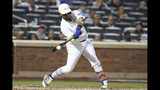 New York Mets' Juan Lagares hits a single during the 10th inning of the team's baseball game against the Atlanta Braves, Friday, Aug. 23, 2019, in New York. (AP Photo/Mary Altaffer)