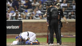 New York Mets catcher Tomas Nido falls to the ground after he was struck by the bat of Atlanta Braves' Josh Donaldson (20) during the sixth inning of a baseball game Friday, Aug. 23, 2019, in New York. (AP Photo/Mary Altaffer)