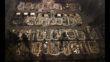 FILE - This Nov. 15, 2018, file photo, shows the remains of residences leveled by a wildfire in Paradise, Calif. Paradise High School, in a Northern California town that was mostly destroyed by a wildfire in November 2018, is scheduled to play its first football game Friday, Aug. 23, 2019. The team will enter the field through the home stands, led by last year's seniors who never got to play in their final game. (AP Photo/Noah Berger, File)