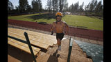 In this Thursday, Aug. 22, 2019, photo, Paradise High School football player Lukas Hartley runs up the stairs of the football stadium after practice in Paradise, Calif. Paradise's game against Williams High School on Friday will be the first game for the team since a wildfire nearly destroyed the foothill community last year. (AP Photo/Rich Pedroncelli)