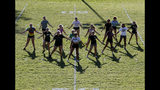 In this Thursday, Aug. 22, 2019, photo, Paradise High School cheerleaders practice in preparation for the football team's first game of the season in Paradise, Calif. Paradise's game against Williams High School on Friday will be the first game since a wildfire nearly destroyed the foothill community last year. (AP Photo/Rich Pedroncelli)