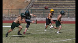 In this Thursday, Aug. 22, 2019, photo, the Paradise High School football team practices kickoffs in preparation for the teams first game of the season in Paradise, Calif. Paradise's game against Williams High School on Friday will be the first game for the team since a wildfire nearly destroyed the foothill community last year. (AP Photo/Rich Pedroncelli)
