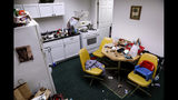 In this Tuesday, July 30, 2019 photo, a mock kitchen designed for training new child service investigators is one of many rooms used in preparing new employees at Illinois Department of Children and Family Services (DCFS) in the Englewood neighborhood of Chicago. Experts say the Illinois welfare agency under fire for high-profile deaths of children has become a national standout when it comes to giving workers hands-on training. The state has two simulation labs where over 700 employees have trained and there are plans for a third. (AP Photo/Amr Alfiky)