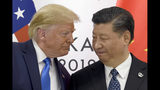 FILE - In this June 29, 2019, file photo, President Donald Trump, left, meets with Chinese President Xi Jinping during a meeting on the sidelines of the G-20 summit in Osaka, Japan. China has announced it will raise tariffs on $75 billion of U.S. products in retaliation for President Donald Trump's planned Sept. 1 duty increase in a war over trade and technology policy. (AP Photo/Susan Walsh, File)
