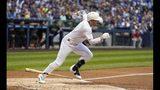 Milwaukee Brewers' Ryan Braun hits an RBI single during the first inning of a baseball game against the Arizona Diamondbacks Friday, Aug. 23, 2019, in Milwaukee. (AP Photo/Morry Gash)
