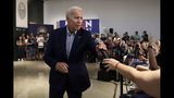 Democratic presidential candidate former Vice President Joe Biden hands a microphone to a questioner during a campaign event at Dartmouth College, Friday, Aug. 23, 2019, in Hanover, N.H. (AP Photo/Elise Amendola)