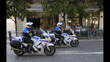 Police officers on motorcycles patrol past a cafe ahead of the G-7 summit in Biarritz, France Friday, Aug. 23, 2019. U.S. President Donald Trump will join host French President Emmanuel Macron and the leaders of Britain, Germany, Japan, Canada and Italy for the annual G-7 summit in the elegant resort town of Biarritz. (AP Photo/Peter Dejong)