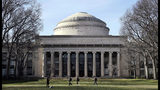 """FILE - In this April 3, 2017 file photo, students walk past the """"Great Dome"""" atop Building 10 on the Massachusetts Institute of Technology campus in Cambridge, Mass. Two prominent researchers are quitting MIT's Media Lab over revelations that the famed technology research hub and its director took money from Jeffrey Epstein after he'd served time for sex offenses involving girls and young women. Ethan Zuckerman, director of the lab's Center for Civic Media, said director Joi Ito had failed to disclose the deceased financier's funding of the Massachusetts Institute of Technology incubator as well as investments Epstein made in Ito's personal venture capital fund, Wednesday, Aug. 21, 2019. (AP Photo/Charles Krupa, File)"""