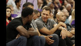"""FILE - In this July 1, 2019, file photo, Sacramento Kings head coach Luke Walton talks with former Sacramento Kings player Chris Webber, left, as Kings general manager Vlade Divac, obscured at center, looks on during the first half of an NBA basketball summer league gamebetween the Kings and Golden State Warriors in Sacramento, Calif. The Sacramento Kings and the NBA have announced that after a thorough investigation there isn't enough evidence to support allegations that new coach Luke Walton sexually assaulted a woman. The team and league began a joint investigation in April following a lawsuit filed in Los Angeles by former sportscaster Kelli Tennant, who """"elected not to participate in the investigation. Based on this and the available evidence, the investigators determined that there was not a sufficient basis to support the allegations made against Coach Walton,"""" the Kings announced in a joint statement with the NBA. (AP Photo/Rich Pedroncelli, File)"""