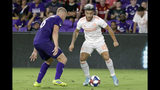 Atlanta United's Hector Villalba (15) looks for a way to get past Orlando City's Robin Jansson during the second half of an MLS soccer match Friday, Aug. 23, 2019, in Orlando, Fla. (AP Photo/John Raoux)