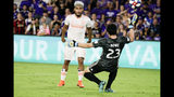 Orlando City goalkeeper Brian Rowe (23) deflects a shot on goal by Atlanta United's Josef Martinez, left, during the second half of an MLS soccer match Friday, Aug. 23, 2019, in Orlando, Fla. (AP Photo/John Raoux)