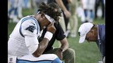 Carolina Panthers quarterback Cam Newton (1) receives attention on the sideline after an injury in the first half of an NFL preseason football game against the New England Patriots, Thursday, Aug. 22, 2019, in Foxborough, Mass. (AP Photo/Charles Krupa)