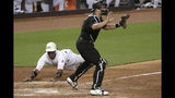 Miami Marlins' Starlin Castro, left, scores past Philadelphia Phillies catcher J.T. Realmuto on a double hit by Neil Walker during the fifth inning of a baseball game, Friday, Aug. 23, 2019, in Miami. (AP Photo/Lynne Sladky)