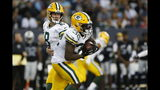 Green Bay Packers quarterback Tim Boyle (8) hands off to Tra Carson (32) during the first half of an NFL preseason football game against the Oakland Raiders on Thursday, Aug. 22, 2019, in Winnipeg, Manitoba. (John Woods/The Canadian Press via AP)