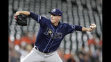 Tampa Bay Rays starting pitcher Ryan Yarbrough throws a pitch to a Baltimore Orioles batter during the third inning of a baseball game Thursday, Aug. 22, 2019, in Baltimore. (AP Photo/Julio Cortez)