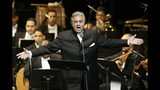 FILE - In this Jan. 22, 2004, file photo, Placido Domingo sings during his performance at the National Theater in Santiago, Dominican Republic. Domingo is scheduled to appear onstage at the Salzburg Festival Aug. 25, 2019, to perform for the first time since multiple women have accused the opera legend of sexual harassment in allegations brought to light by The Associated Press. (AP Photo/Miguel Gomez, File)