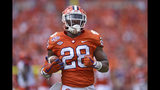FILE - In this Sept. 29, 2018, file photo, then-Clemson's Tavien Feaster rushes up the field during the first half of an NCAA college football game against Syracuse in Clemson, S.C. South Carolina tailback Rico Dowdle leads a running game featuring three seniors and Clemson graduate transfer Tavien Feaster, who switched sides after three years and two national championship rings with the Tigers. (AP Photo/Richard Shiro, File)
