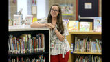 First-grade teacher Hillary Madrigal is photographed at her school Thursday, Aug. 22, 2019, in Salt Lake City. Across the country, teachers and school districts alike are grappling with the latest political and economic realities of educator pay. Madrigal jumped to the nearby school district last year, lured by higher salaries that would allow her to quit her second job as a housekeeper and buy a new car. (AP Photo/Rick Bowmer)