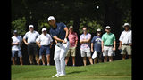 Xander Schauffele hits to the seventh green during the second round of the Tour Championship golf tournament Friday, Aug. 23, 2019, in Atlanta. (AP Photo/John Amis)