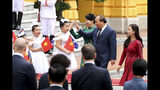 Vietnamese Prime Minister Nguyen Xuan Phuc, accompanied by his wife Tran Nguyet Thu, third from right, arrives for a welcome ceremony for visiting Australian Prime Minister Scott Morrison at the Presidential Palace in Hanoi, Vietnam, Friday, Aug. 23, 2019. Morrison is on a three-day official visit to Vietnam. (AP Photo/Duc Thanh)