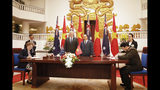 Australian Prime Minister Scott Morrison, center left, and his Vietnamese counterpart Nguyen Xuan Phuc, center right, attend a signing ceremony at the Government Office in Hanoi, Vietnam, Friday, Aug. 23, 2019. (AP Photo/Duc Thanh)