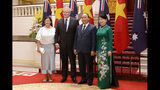 Australian Prime Minister Scott Morrison, second from left, and his wife Jenny Morrison, left, pose with Vietnamese Prime Minister Nguyen Xuan Phuc and his wife Tran Thi Nguyet Thu for a photo during a welcome ceremony at the Presidential Palace in Hanoi, Vietnam, Friday, Aug. 23, 2019. Morrison is on a three-day official visit to Vietnam. (AP Photo/Duc Thanh)