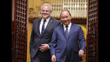 Australian Prime Minister Scott Morrison, left, and his Vietnamese counterpart Nguyen Xuan Phuc walk to a press briefing at the Government Office in Hanoi, Vietnam, Friday, Aug. 23, 2019. (AP Photo/Duc Thanh)