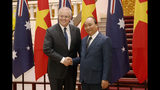 Australian Prime Minister Scott Morrison, left, and his Vietnamese counterpart Nguyen Xuan Phuc pose for a photo during a welcome ceremony at the Presidential Palace in Hanoi, Vietnam, Friday, Aug. 23, 2019. Morrison is on a three-day official visit to Vietnam. (AP Photo/Duc Thanh)