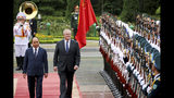 Australian Prime Minister Scott Morrison, second from left, with his Vietnamese counterpart Nguyen Xuan Phuc reviews an honor guard during a welcome ceremony at the Presidential Palace in Hanoi, Vietnam, Friday, Aug. 23, 2019. Morrison is on a three-day official visit to Vietnam. (AP Photo/Duc Thanh)