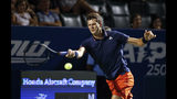 Hubert Hurkacz, of Poland, reaches for a serve from Denis Shapovalov, of Canada, in the semifinals of the Winston-Salem Open tennis tournament in Winston-Salem, N.C., Friday, Aug. 23, 2019. Hurkacz won 6-3, 6-4. (AP Photo/Nell Redmond)