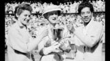 FILE - In this July 7, 1956, file photo, the Duchess of Kent, center, presents the trophy for the Ladies' Doubles title to Angela Buxton, left, and Althea Gibson, right, following their victory at Wimbledon, England. Gibson won an amazing 11 Grand Slam titles in three years from 1956-58, including the French Open, Wimbledon and U.S. Open. On Monday, Aug. 26, 2019, the USTA will unveil a statue in her honor at the U.S. Open. (AP Photo/File)