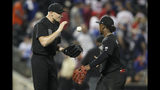 Atlanta Braves second baseman Ozzie Albies, right, tosses relief pitcher Mark Melancon a baseball as they celebrate after the Braves defeated the New York Mets 2-1 in 14 innings in a baseball game Friday, Aug. 23, 2019, in New York. (AP Photo/Mary Altaffer)