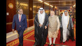 In this photo released by the state-run WAM news agency, Indian Prime Minister Narendra Modi, second from right, walks with Khaldoon Khalifa al-Mubarak, second from left, chairman of the Abu Dhabi Executive Affairs Authority, after arriving in Abu Dhabi, United Arab Emirates, Friday, Aug. 23, 2019. Modi is on a trip to both the United Arab Emirates and Bahrain, reinforcing ties between India and the Gulf Arab nations as he pursues stripping statehood from the disputed Muslim-majority region of Kashmir. (WAM via AP)