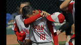 Japan's Yuto Misaki (18) and Haruto Owada walk off the field after the 5-4 loss to Curacao in the International Championship baseball game at the Little League World Series tournament in South Williamsport, Pa., Saturday, Aug. 24, 2019. (AP Photo/Tom E. Puskar)