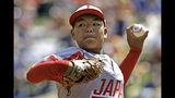 Japan's Taishi Kawaguchi (24) delivers during the second inning of the International Championship baseball game against Curacao at the Little League World Series tournament in South Williamsport, Pa., Saturday, Aug. 24, 2019. (AP Photo/Gene J. Puskar)