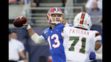 Florida quarterback Feleipe Franks (13) throws a pass as he is pressured by Miami defensive lineman Scott Patchan (71) during the first half of an NCAA college football game Saturday, Aug. 24, 2019, in Orlando, Fla. (AP Photo/John Raoux)