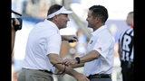 Florida coach Dan Mullen, left, greets Miami coach Manny Diaz before an NCAA college football game Saturday, Aug. 24, 2019, in Orlando, Fla. (AP Photo/John Raoux)