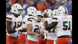 Miami place kicker Bubba Baxa (21) celebrates his 36-yard field goal against Florida with teammates, including quarterback Jarren Williams (15) and offensive lineman DJ Scaife Jr. (51), during the first half of an NCAA college football game Saturday, Aug. 24, 2019, in Orlando, Fla. (AP Photo/John Raoux)
