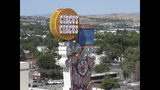 This photo taken Aug. 19, 2019 shows the famous clown at the Circus Circus casinos famous clown in front one of its downtown Reno, Nev., casino hotel where about 1,300 University of Nevada students are living this year after a gas explosion in July shut down two major dorms. The non-gambling, non-smoking building leased to the university for $21.7 million has been converted into Wolf Pack Hall exclusively for students through the 2019-2020 school year. (AP Photo/Scott Sonner)