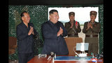 "This Saturday, Aug. 24, 2019, photo provided Sunday, Aug. 25, by the North Korean government, shows North Korean leader Kim Jong Un, center, claps hands as Kim watches the test firing of an unspecified missile at an undisclosed location in North Korea. North Korea fired two suspected short-range ballistic missiles off its east coast on Saturday in the seventh weapons launch in a month, South Korea's military said, a day after it vowed to remain America's biggest threat in protest of U.S.-led sanctions on the country. The content of this image is as provided and cannot be independently verified. Korean language watermark on image as provided by source reads: ""KCNA"" which is the abbreviation for Korean Central News Agency. (Korean Central News Agency/Korea News Service via AP)"